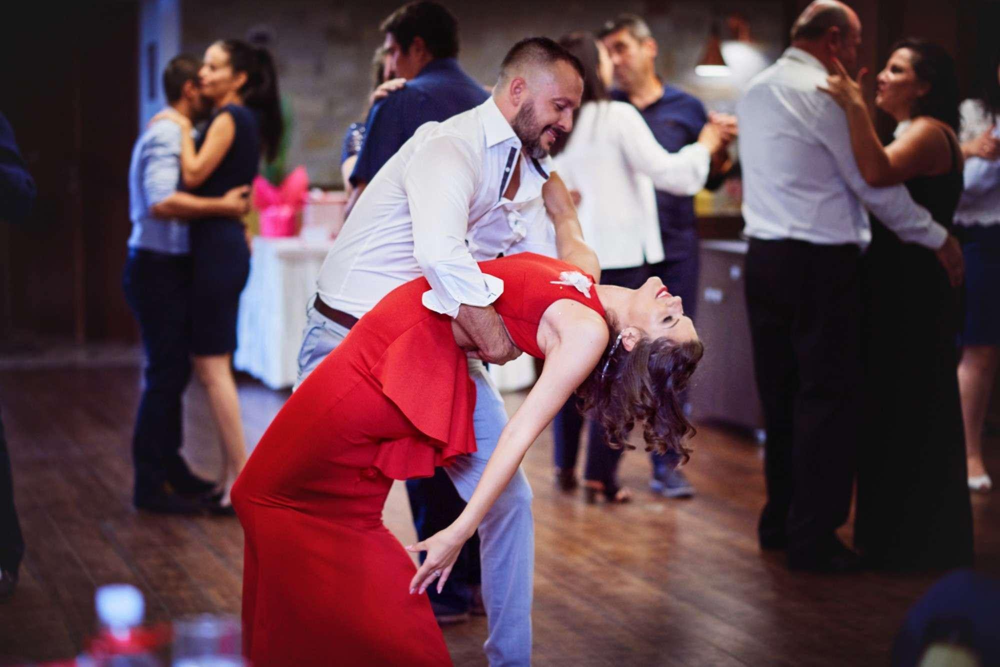 - A group of people walking on the floor - Ballroom dance