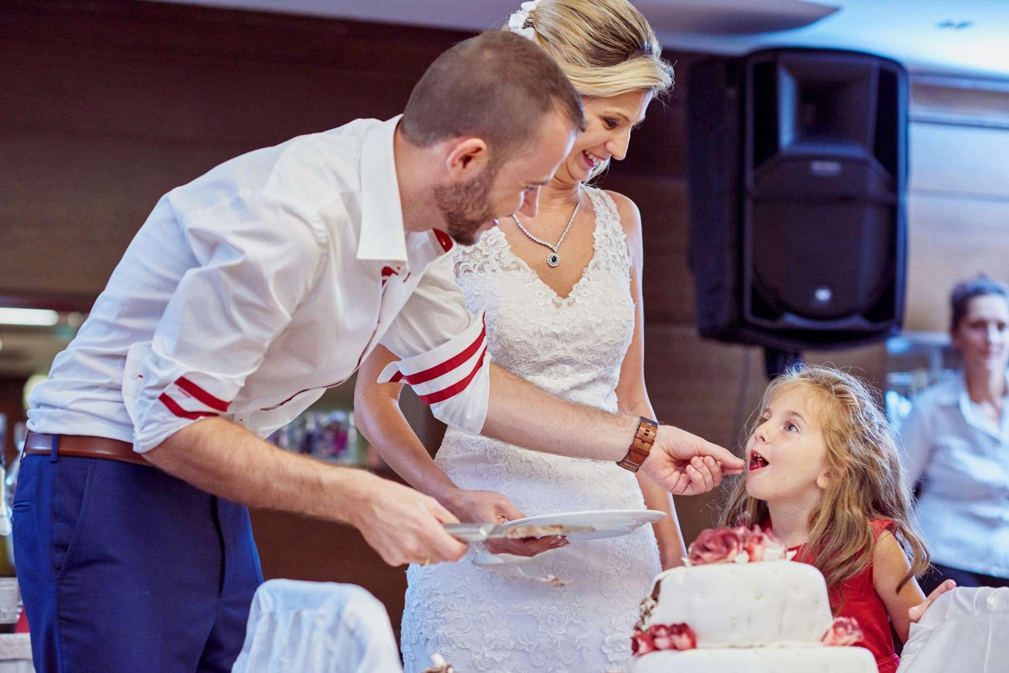 - A person cutting a cake - Kodak Photo